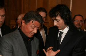 Stefan Chapovsky presented Sylvester Stallone with an award in 2013 for his contributions to natural bodybuilding.